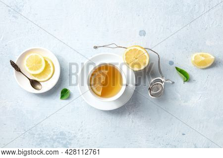 Lemon Tea, Overhead Flat Lay Shot. Organic Lemons And Green Leaves, Shot From The Top. Healthy Detox