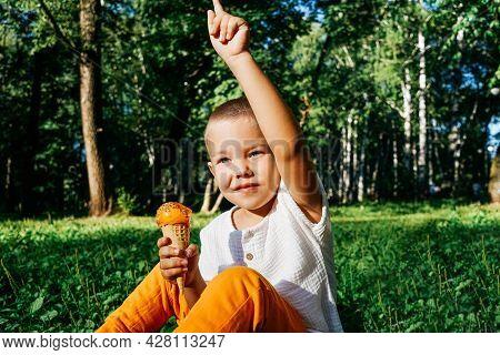 Happy Kid Boy Eating Orange Ice Cream.