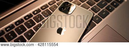 Minsk, Belarus - 30 July 2020: Iphone 12 Pro Max Lying On Laptop Keyboard Closeup