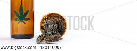 Marijuana Oil Extract And Dried Leaves On White Background