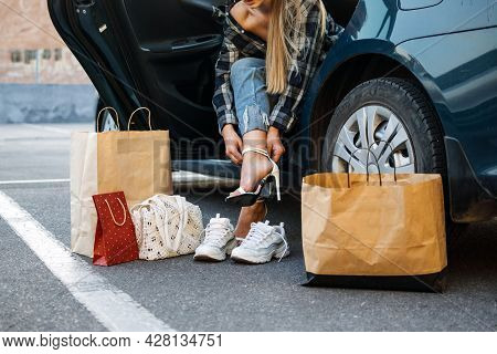 Driving Shoes For Car Enthusiasts. Driving Shoes For Woman To Wear On The Road. Woman Changes High H