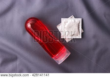 An Intimate Lubricant For Comfortable Sex Close-up On A Colored Background.