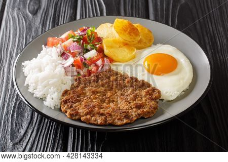 Silpancho Is A Typical Popular Bolivian Food From The City Of Cochabamba Closeup In The Plate On The