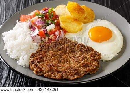 Silpancho Rice Golden Potatoes, Beef, And Fried Eggs Are Topped With An Onion And Tomato Salsa In Th