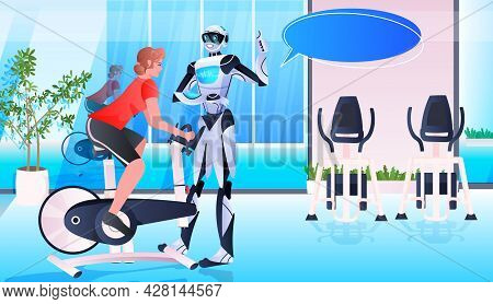 Sportswoman Riding Stationery Bicycle With Robot Instructor Workout Healthy Lifestyle Artificial Int