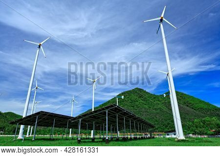 Wind Turbines And Blue Sky With Clouds