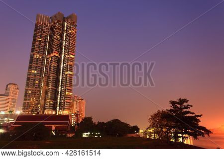High Building With Colorful Sky At Night And Blank Space