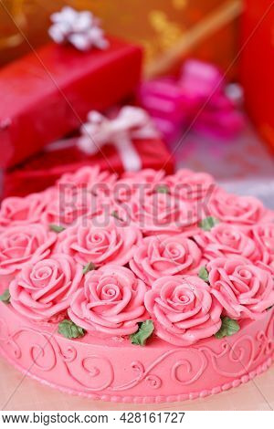 Docorated On Cake And Gift Boxes In Background