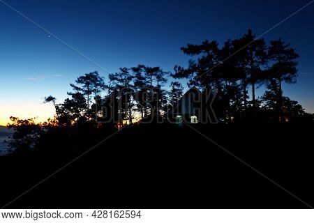 Colorful Sky And House In Forest At Twilight