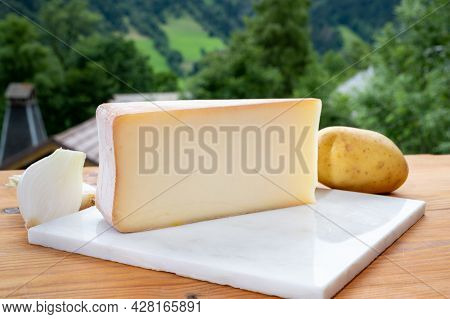 Tastes Of Savoia, French Cow Cheese For Gratin Abondance, Potatoes And French Mountains Village In H