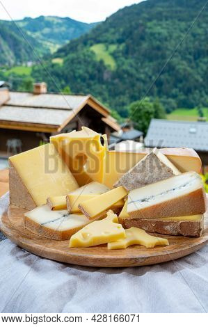 Cheese Collection, Wooden Board With French Cheeses Comte, Beaufort, Abondance, Emmental, Morbier An
