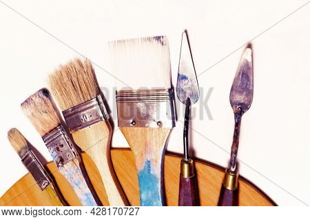 Large Flat Brushes For Acrylic And Oil Painting And Few Types Of Palette Knife Are On The Palette. A