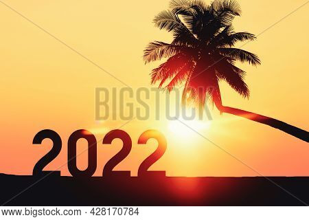 2022 Number With Palm Tree On Tropical Sunset Beach Abstract Background. Happy New Year And Holiday