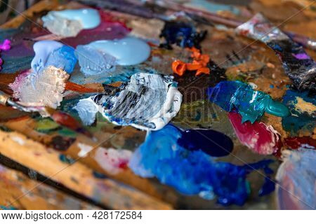 Closeup Palette With Paintbrush And Palette-knife At Studio Or Home Background.