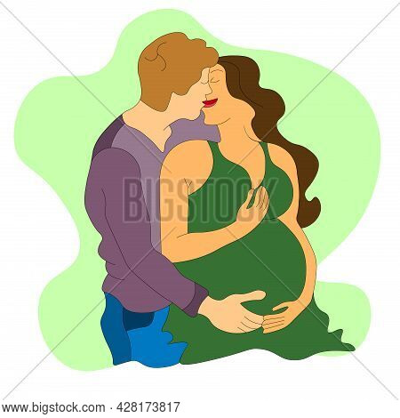 Happy Husband Hugs And Kisses His Pregnant Wife In A Green Dress. They Are Expecting A Child. Future