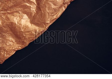 Kraft Paper Texture For Wrapping On Black Background. Kraft Paper Texture Background. Crumpled Brown