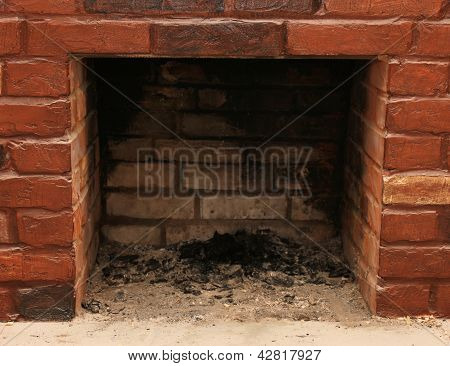Backdrop of a brick fireplace wall in a vacant setting poster