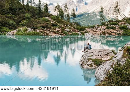 Backpacker Woman With Backpack Enjoying The Turquoise Lago Di Sorapiss 1,925m Altitude (mountain Lak