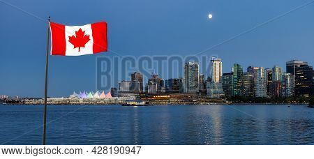 Marina And Downtown Modern City Skyline In Coal Harbour Viewed From Stanley Park. Sunset Twilight In