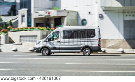 Moscow, Russia - July 2021: White Cargo Van Ford Transit In The City Street