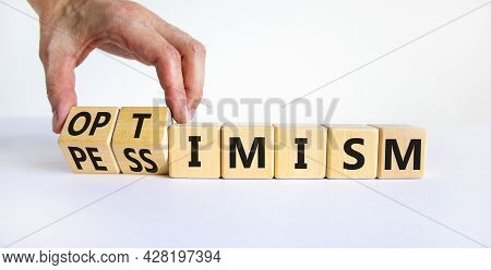 Pessimism Or Optimism Symbol. Businessman Turns Cubes And Changes The Word 'pessimism' To 'optimism'
