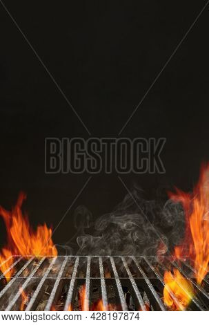Hot Empty Barbecue Bbq Grill With Bright Flaming Fire, Ember Charcoal And Smoke On Black Background.
