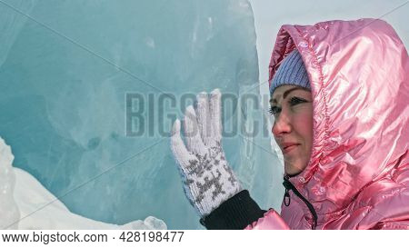 Girl Walking On Cracked Ice Of A Frozen Lake Baikal. Woman Trave