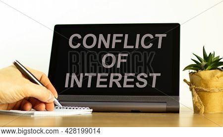 Conflict Of Interest Symbol. Tablet With Words 'conflict Of Interest'. Businessman Hand With Pen, Ho