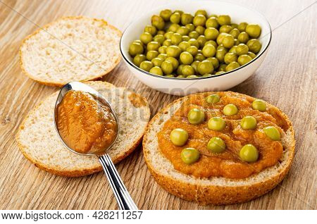Slice Of Bread, Green Peas In Bowl, Squash Caviar In Spoon On Slice Of Bun, Sandwich With Vegetable