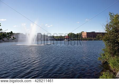 Sherbrooke, Canada - July 28, 2021: Fountain At Lac Des Nations Lake Eastern Townships French City