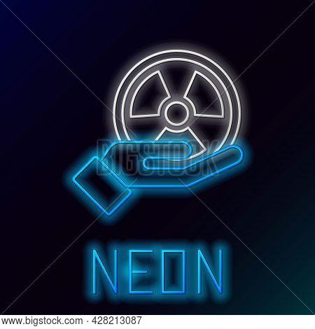 Glowing Neon Line Radioactive In Hand Icon Isolated On Black Background. Radioactive Toxic Symbol. R