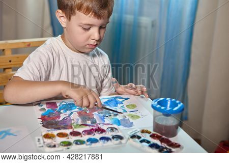 A Boy Draws With Paints At A Table In His Room. High Quality Fullhd Footagea Boy Draws With Paints A