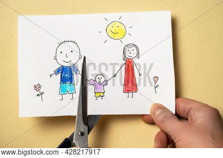 Childs Drawing, Which Depicts Mom, Dad And Child, Is Cut With Scissors. Scissors Cuts Off Dad In The