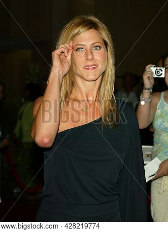 LOS ANGELES - AUG 19: Jennifer Aniston arrives for the 2nd Annual 'Runway For Life' Celebrity Fashion Show on August 19, 2003 in Beverly Hills, CA