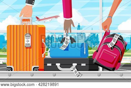 Luggage Carousel Against In Airport. Conveyor Belt With Passenger Luggage. Baggage Claim In Airport