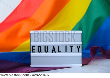 Rainbow Flag With Lightbox And Text Equality. Rainbow Lgbtq Flag Made From Silk Material. Symbol Of