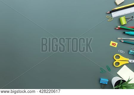 Back To School Conceptual Flat Lay With Different Office Supply Objects On Green Background. Concept