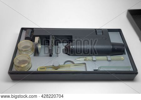 Educational Microscope In Portable Case For Storing With Tools And Asseseories. With Clipping Path