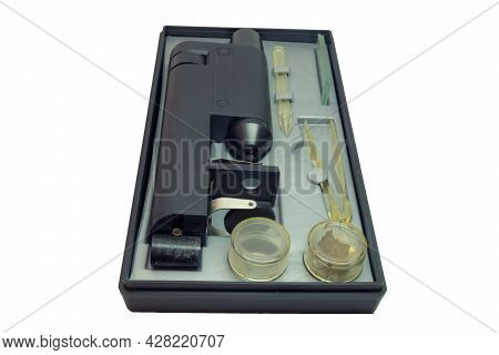 Educational Microscope In Portable Case For Storing With Tools And Asseseories. Isolated On White Ba