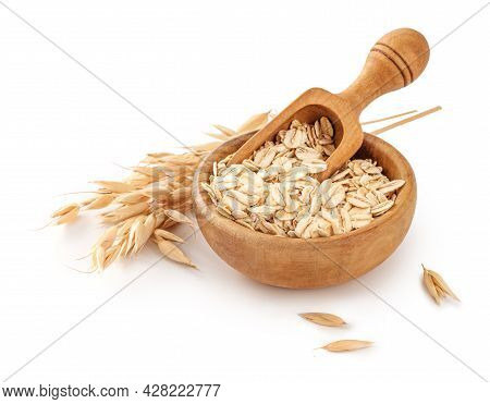 Oat Flake In Wooden Bowl With Spoon And Spikelets Of Oats Isolated. Bowl Of Oats On White Background
