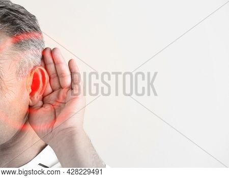 Mature Man Suffering From Earache On Light Background, Closeup. Space For Text