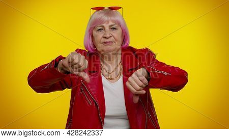 Upset Elderly Rocker Woman With Pink Hair Showing Thumbs Down Sign Gesture, Expressing Discontent, D