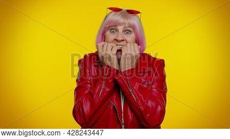 Upset Scared Frightened Elderly Stylish Rocker Granny Woman Biting Nails, Feeling Worried Nervous Ab