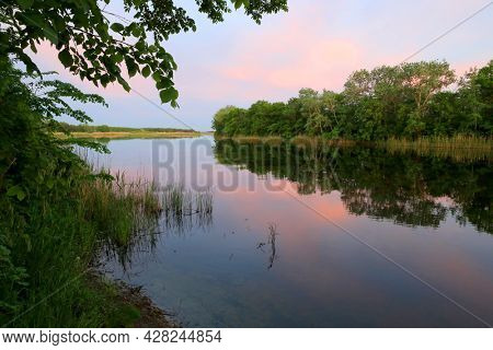 quiet evening landscape on summer river in Ukraine