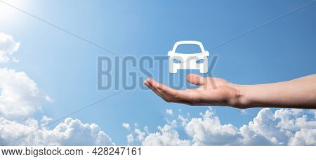 Male Hand Holding Car Auto Icon On Blue Background. Wide Banner Composition.car Automobile Insurance