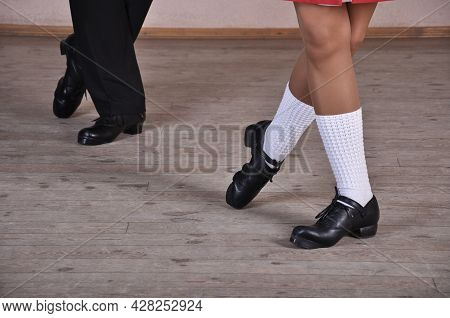 Close-up Of A Man And Woman Dancing Traditional Irish Dances. Legs Of Dance Partners