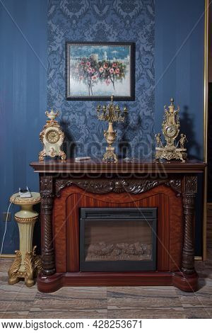 Brown Fireplace . Electric Fireplace In A Wooden Portal In The Room . Fireplace Isolated On Blue Bac