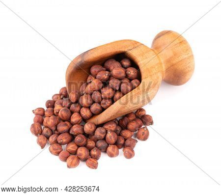 Pile Of Brown Chickpeas In Wooden Scoop, Isolated On White Background. Brown Chickpea. Garbanzo, Ben