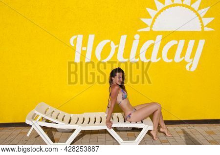 Holiday Text On Yellow Wall. Sexy Girl With Wet Hair. Lady In Swimming Suit. Summer Resort With Beac
