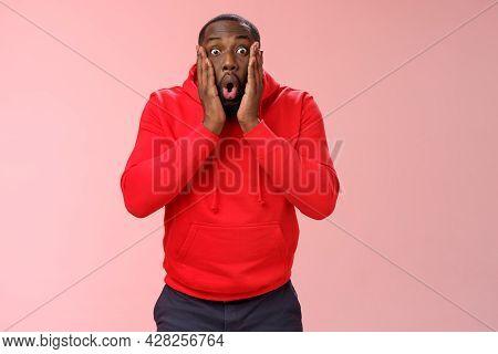 Wow Incredible. Portrait Impressed Surprised African-american Bearded Guy In Red Hoodie Folding Lips